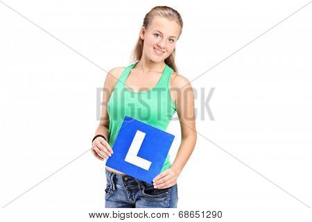 Young girl holding a L sign isolated on white background