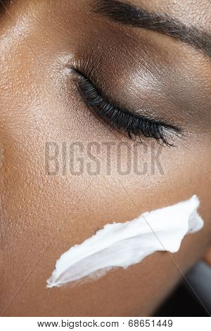 Black Woman With Ideal Skin Use A Cream