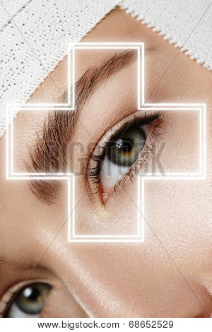 Woman's Eye With A Glowing Cross