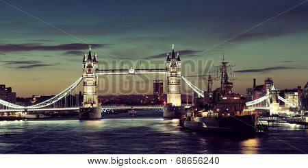 HMS Belfast warship and Tower Bridge panorama in Thames River in London