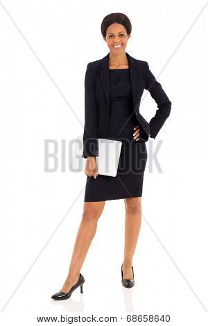 happy mid age african businesswoman holding laptop isolated on white background