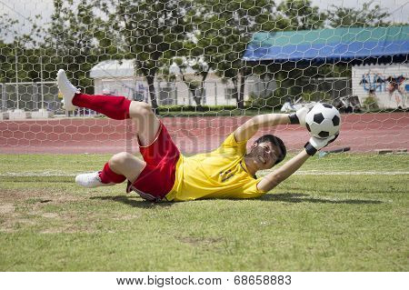 Goalkeeper Catches The Soccer Ball