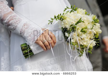 Bride Holding Freesia Flowers