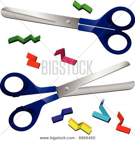 Two Scissors with cut paper pieces.