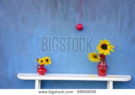 Summer Still-life With Red Vases, Flowers And Apple