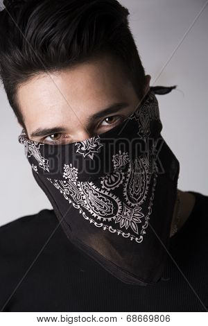 Man With His Face Hidden Behind A Bandanna