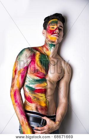 Attractive Young Man Shirtless, Skin Painted All Over With Colors