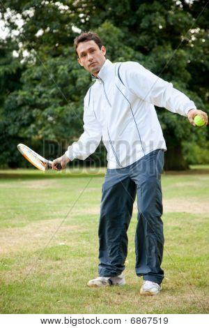 Man Practicing Tennis