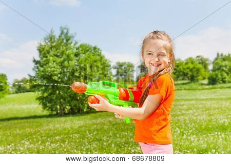 Nice girl playing with water gun