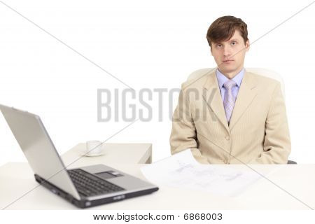 Young Serious Person On A Workplace