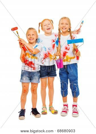 Three smiling girls with brushes