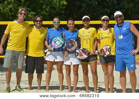 MOSCOW, RUSSIA - JULY 20, 2014: Teams Italy (blue shirts) and Brazil before the final match during ITF Beach Tennis World Team Championship. Italy won 2-0
