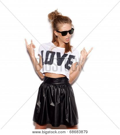 Young Woman With Sunglasses Giving  Rock And Roll Sign