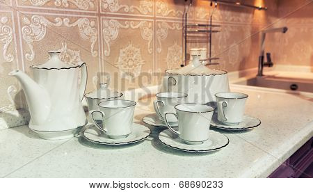 Cups of tea with a teapot
