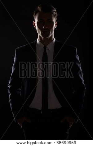 Handsome Business Man In Black Suite, Backlight