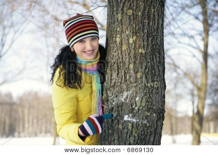 teen girl with snowball, surprised