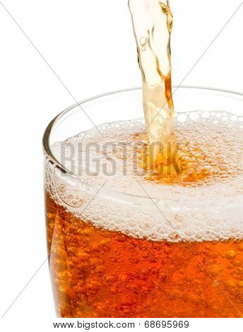 Pouring Beer In Glass Isolated On White Background