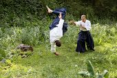 stock photo of aikido  - Training martial art Aikido. On nature. outdoors.