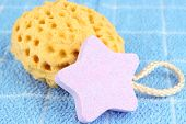 stock photo of bath sponge  - Sea salt and sponge for bathing - JPG