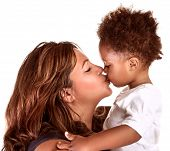 picture of family love  - Portrait of cheerful mother kissing baby - JPG