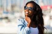 picture of denim wear  - beautiful young african woman wearing sunglasses - JPG