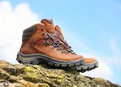 image of boot camp  - Trekking boots on the rock - JPG