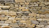 picture of gneiss  - Old stone wall closeup in sunny day