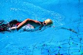stock photo of triathlon  - Swimming man in the pool during a triathlon in Germany - JPG
