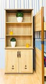 stock photo of armoire  - Beautiful wooden cupboard in children - JPG