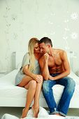 pic of nightgown  - Young couple sitting on the bed a thome - JPG