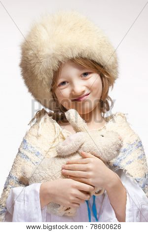 Portrait Of A Boy With Fluffy Hat And Stuffed Animal
