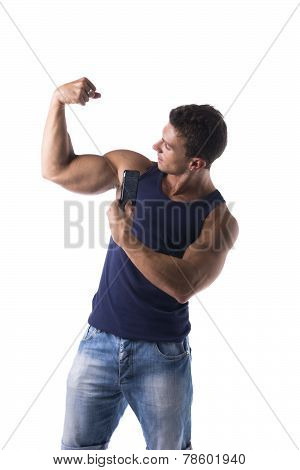 Strong Muscular Man Flexing His Arm Muscles