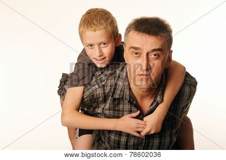 Ten Year Old Son Cheerfully Embraced His Father Sitting On His Back