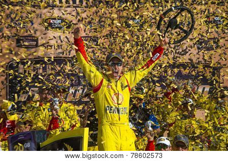 Kansas, KS - Oct 05, 2014:  Joey Logano (22) wins the Hollywood Casino 400 at Kansas Speedway in Kansas, KS.