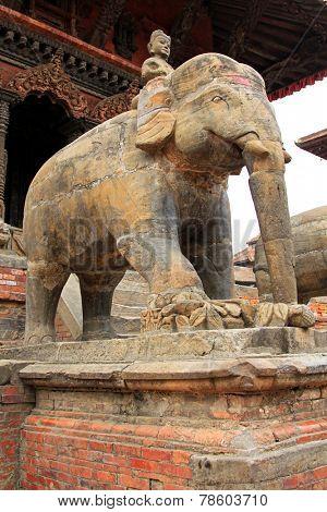 PATAN, NEPAL - APRIL 2014 : A large stone elephant guarding the Vishwanath (Shiva) Temple in Patan, Nepal on 13 April 2014. Shiva also known as Mahadeva is a Hindu deity.