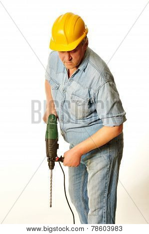 Worker In A Yellow Hardhat With Perforator