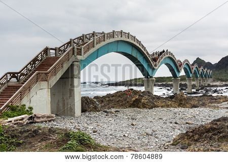 TAITUNG, TAIWAN - DEC 14th : Famous bridge at Sanxiantai, with many tourists on December 14th, 2014 in Chenggong Township, Taitung County, Taiwan, Asia.