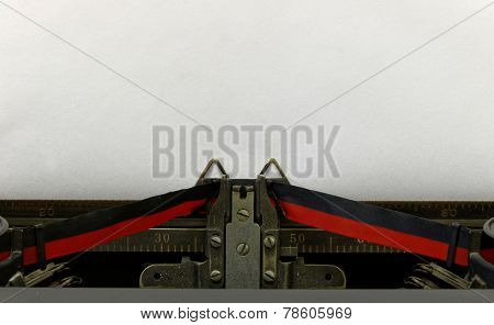 Empty Sheet In Old Style Typewriter