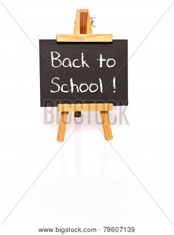 Back to school. Blackboard with text and easel.