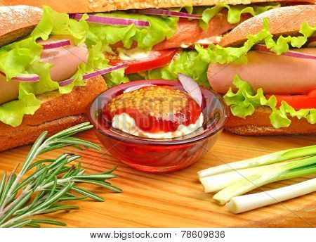 Tasty Fresh Sandwiches With Green Lettuce, Ham, Green Onion And Sauce On Cutting Board