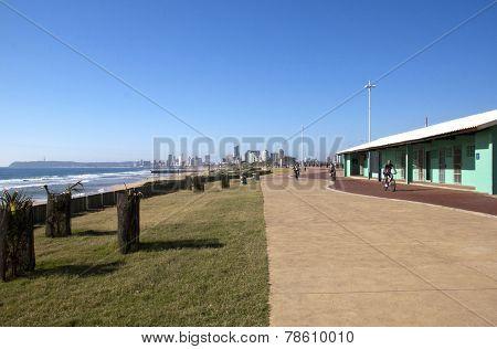 Three Cyclists Riding Along Beach Front Promenade