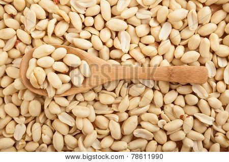 Peeled Peanuts With Wooden Spoon