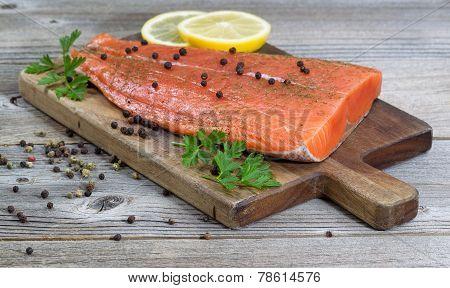 Seasoned Salmon Fillet On Rustic Wood