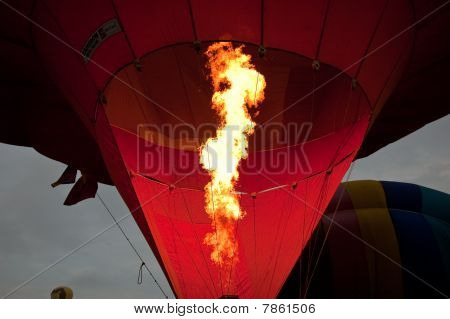 Filling a hot-air balloon with some warmth