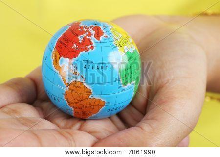 Female Hand Holding A Globe