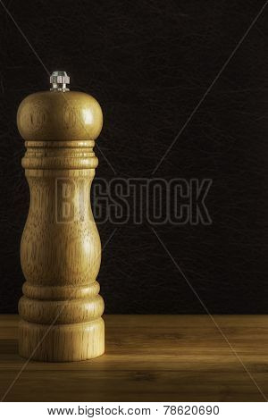 Wooden pepper mill on kitchen table