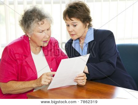 Senior Woman Reading Paperwork