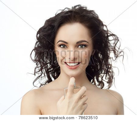closeup portrait of attractive  caucasian smiling woman brunette isolated on white studio shot lips toothy smile face hair head and shoulders looking at camera applying perfume