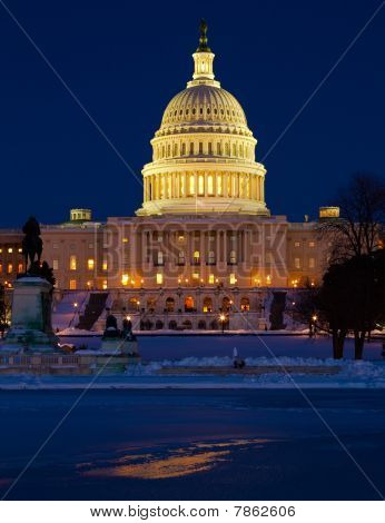 US Capitol under Snow at Twilight