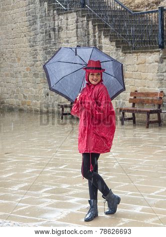 Young Woman Standing In The Rain